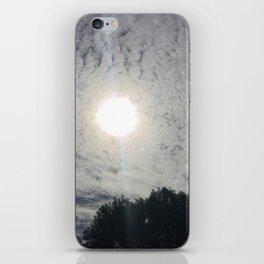 sun behind clouds iPhone Skin