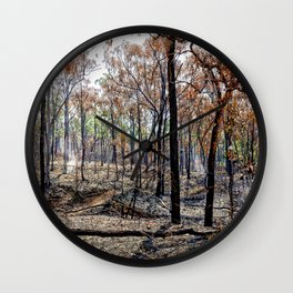 Fire damaged forest Wall Clock