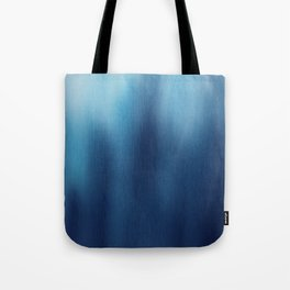 Human Figures In Blue Tote Bag