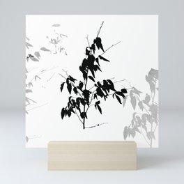 Sapling in the snow Mini Art Print