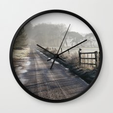 Remote frozen country road a t sunrise. Norfolk, UK. Wall Clock