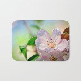 Closeup view of a pink crabapple flower. Soft background Bath Mat