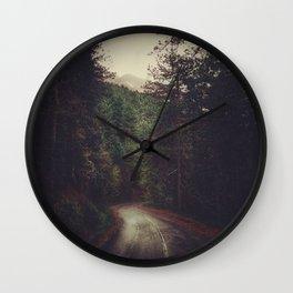 Wander inside the mountains Wall Clock