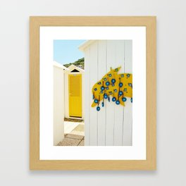 Yellow dolphin with blue keys Framed Art Print