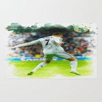 ronaldo Area & Throw Rugs featuring Cristiano Ronaldo celebrates after scoring by Don Kuing
