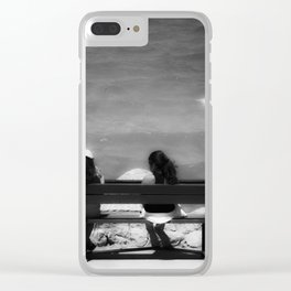 Two girls sitting on a bench at sea side Clear iPhone Case