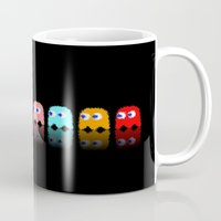 pac man Mugs featuring Pac Man by Emma Kennedy