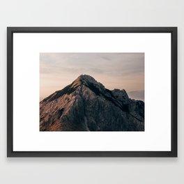 Red peak in sunrise light Framed Art Print