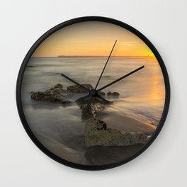 Orange sunset by the beach Wall Clock