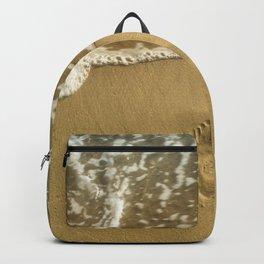 footprint on the beach Backpack
