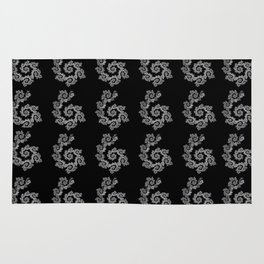 Dancing flowers in black and white Rug