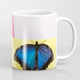 Morpho butterfly sitting on the colored background Coffee Mug