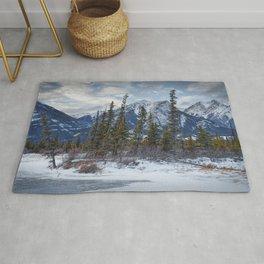 Pines at the edge of a lake in Jasper National Park Rug