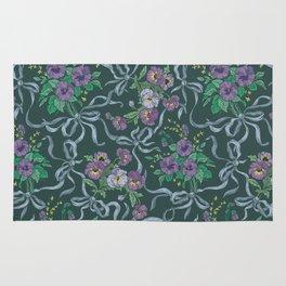 Violet with sweet peas flowers on dark background Rug
