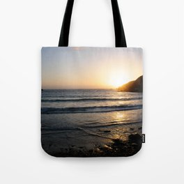 Sunset with golden ocean Tote Bag