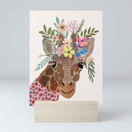Giraffe with flowers on head Mini Art Print
