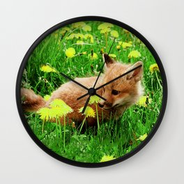 Baby Red Fox in Green Field With Yellow Flowers Wall Clock