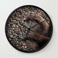 otters Wall Clocks featuring Pair of Otters by Eleven Collective