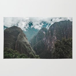 Blue morning mist over the Andes mountains and river near Machu Picchu, Peru Rug
