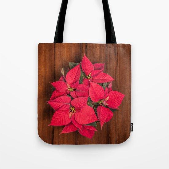 Red Christmas flower on brown wood Tote Bag