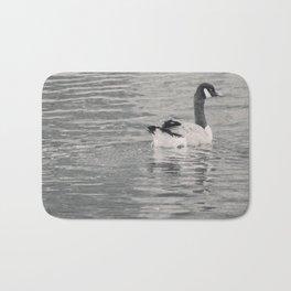 Goose on the lake Bath Mat