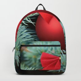 Red Christmas bauble on a fir tree Backpack