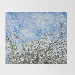 Soft spring white flowers against blue sky Throw Blanket