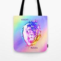 hakuna Tote Bags featuring Hakuna Matata by Laura Santeler
