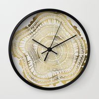 black and gold Wall Clocks featuring Gold Tree Rings by Cat Coquillette