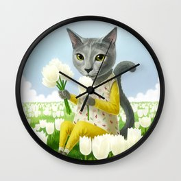 A cat sitting in the flower garden Wall Clock