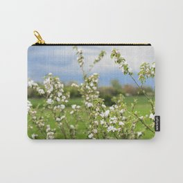 Flowering branches of an apple tree against a blue stormy sky Carry-All Pouch