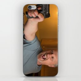 Angry Man with handgun in kitchen iPhone Skin