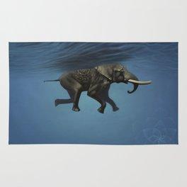 elephant underwater Rug