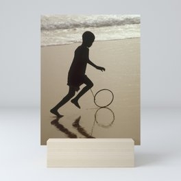 Silhouette on an African Beach. Mini Art Print