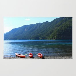 Lake Crescent With Beached Canoes Rug