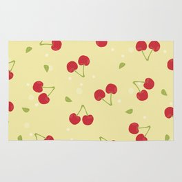 Red cherries in a yellow background Rug