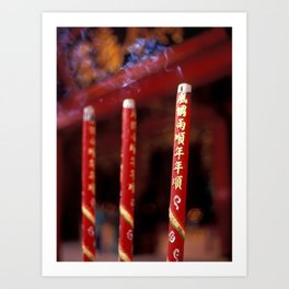 Candle sticks in font of buddhist temple Art Print