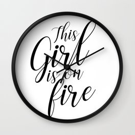 This girl is on fire Wall Clock