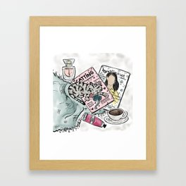 Kitty Sleeping on Magazines Framed Art Print