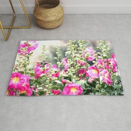 Chuparosa checking out all the Pink Pink Hollyhocks by CheyAnne Sexton Rug