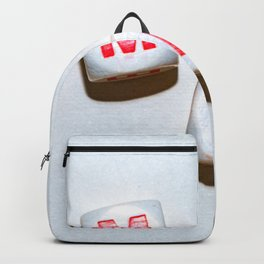 dice with letters make up the word smile Backpack