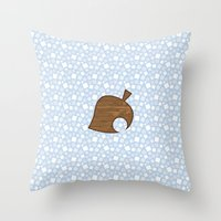 animal crossing Throw Pillows featuring Animal Crossing Winter Leaf by Rebekhaart
