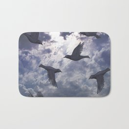 crows in the stormy sky Bath Mat