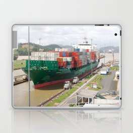 A cargo ship crossing the Miraflores locks at the Panama Canal Laptop & iPad Skin