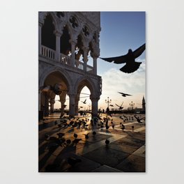 Sunrise at San Marco Square, Venice, Italy. Pigeons flying near the Doge`s Palace. Canvas Print
