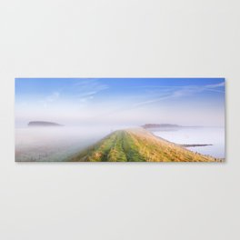 Typical Dutch landscape in Zeeland on a foggy morning Canvas Print