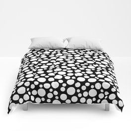 White polka dots on a black background. Comforters
