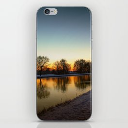 Winter sun early morning waterfront iPhone Skin