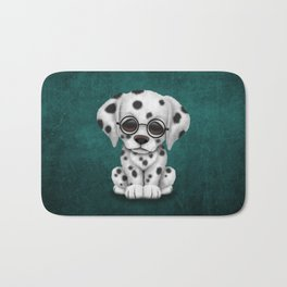 Dalmatian Puppy Wearing Reading Glasses on Blue Bath Mat