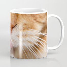 Detail of the muzzle of a Maine Coon cat sticking its tongue out Coffee Mug